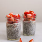 chia seed puddings in jars with strawberries