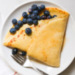 sourdough crepe with blueberries and syrup