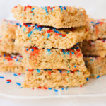 rice krispies treats stacked together with sprinkles