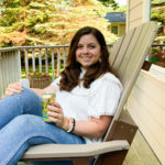 sitting on a chair on the back deck