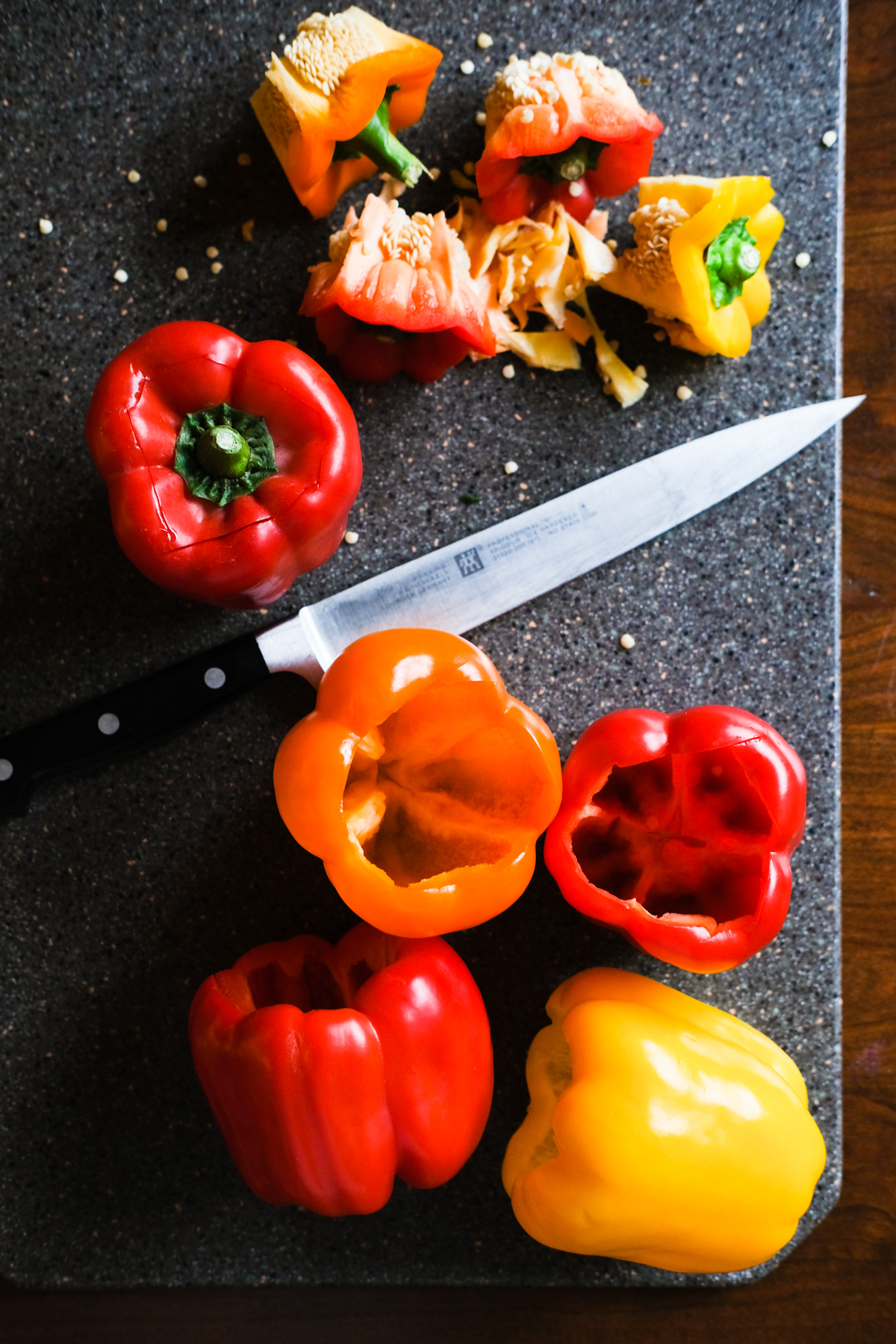 cutting peppers to make stuffed peppers