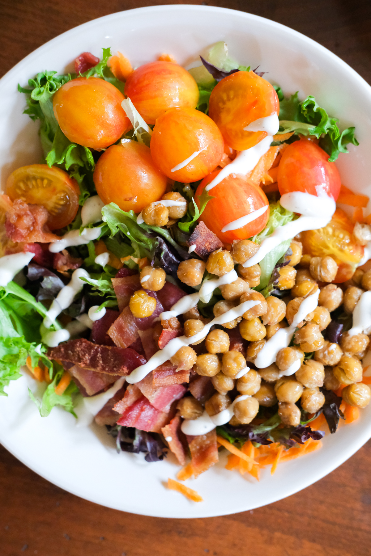chickpea salad with cherry tomatoes bacon and salad greens
