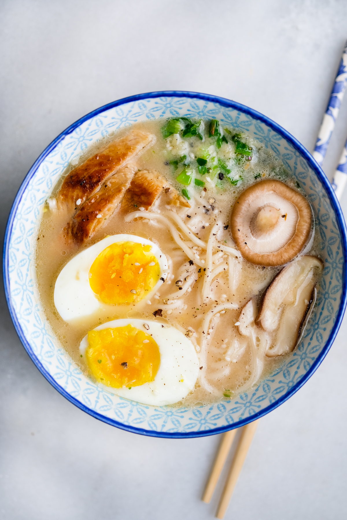 upgraded chicken ramen in a bowl with egg chicken and mushrooms