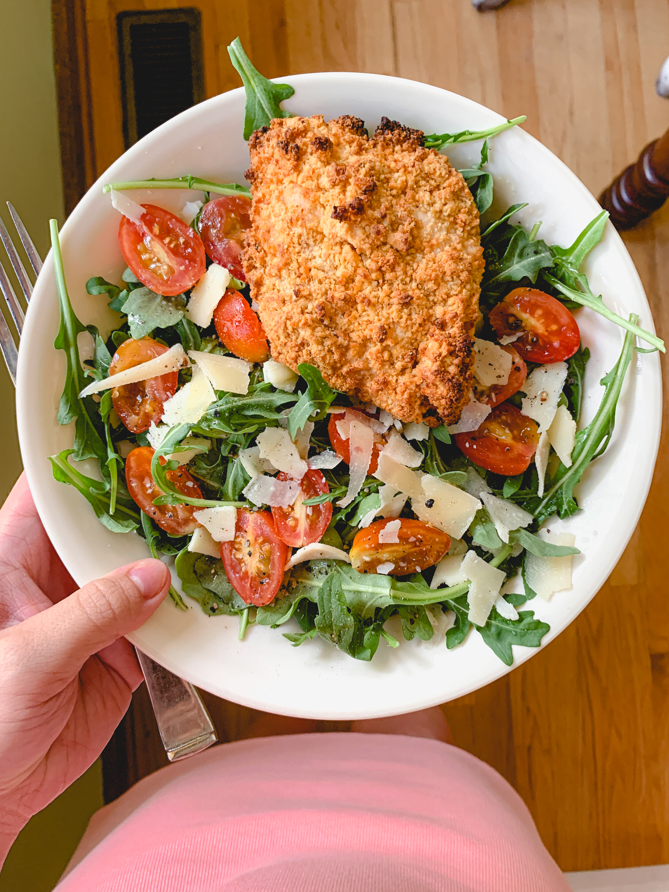 crispy chicken arugula salad with cherry tomatoes and parmesan
