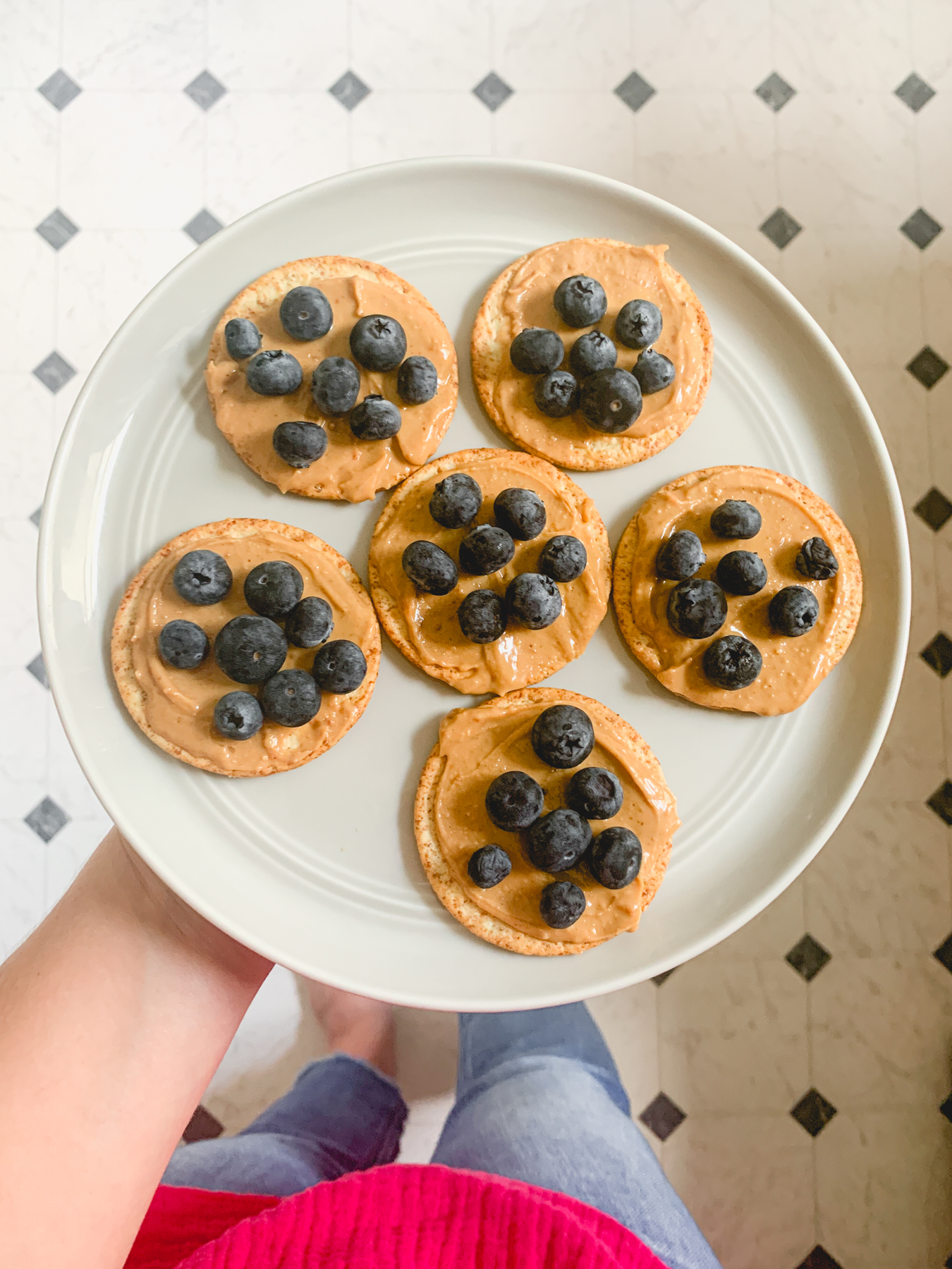 peanut butter whole grain crackers with blueberries