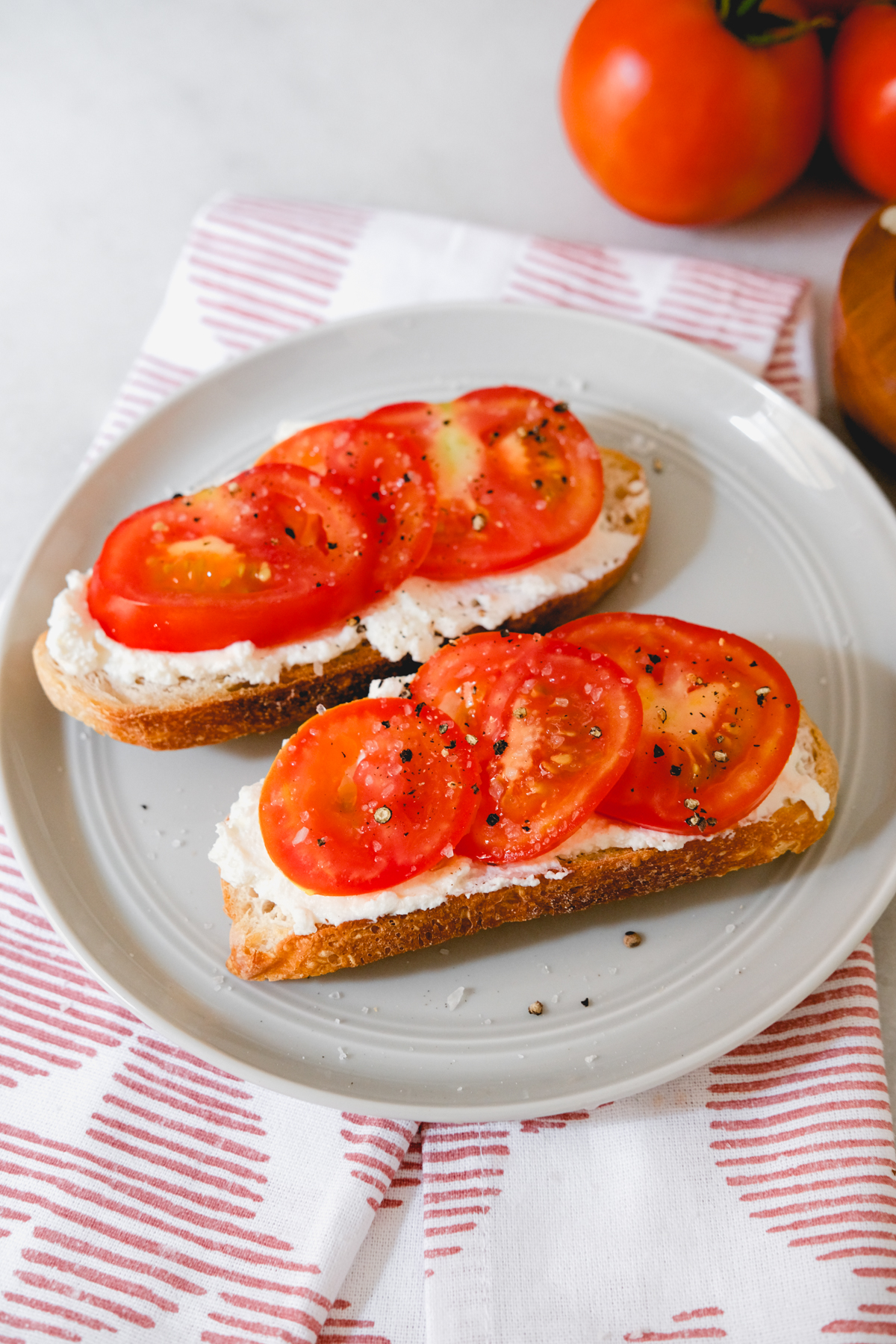 tomato ricotta toast with salt and pepper