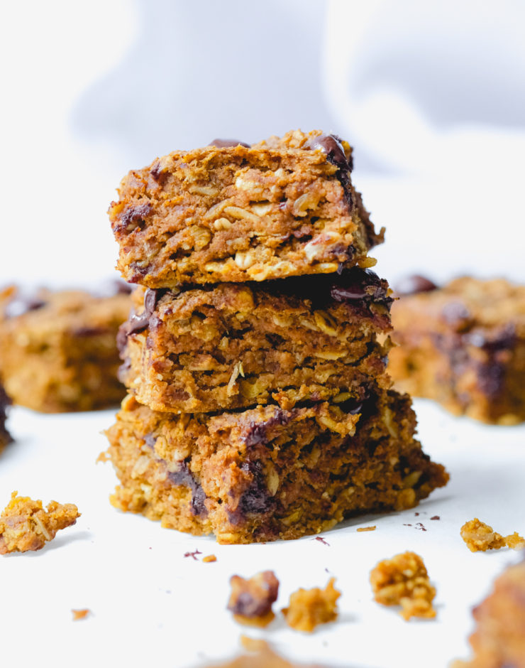 pumpkin chocolate chip oat bars stacked on top of each other