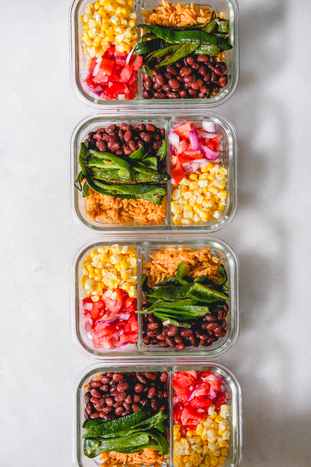 roasted veggie burrito bowls in meal prep containers