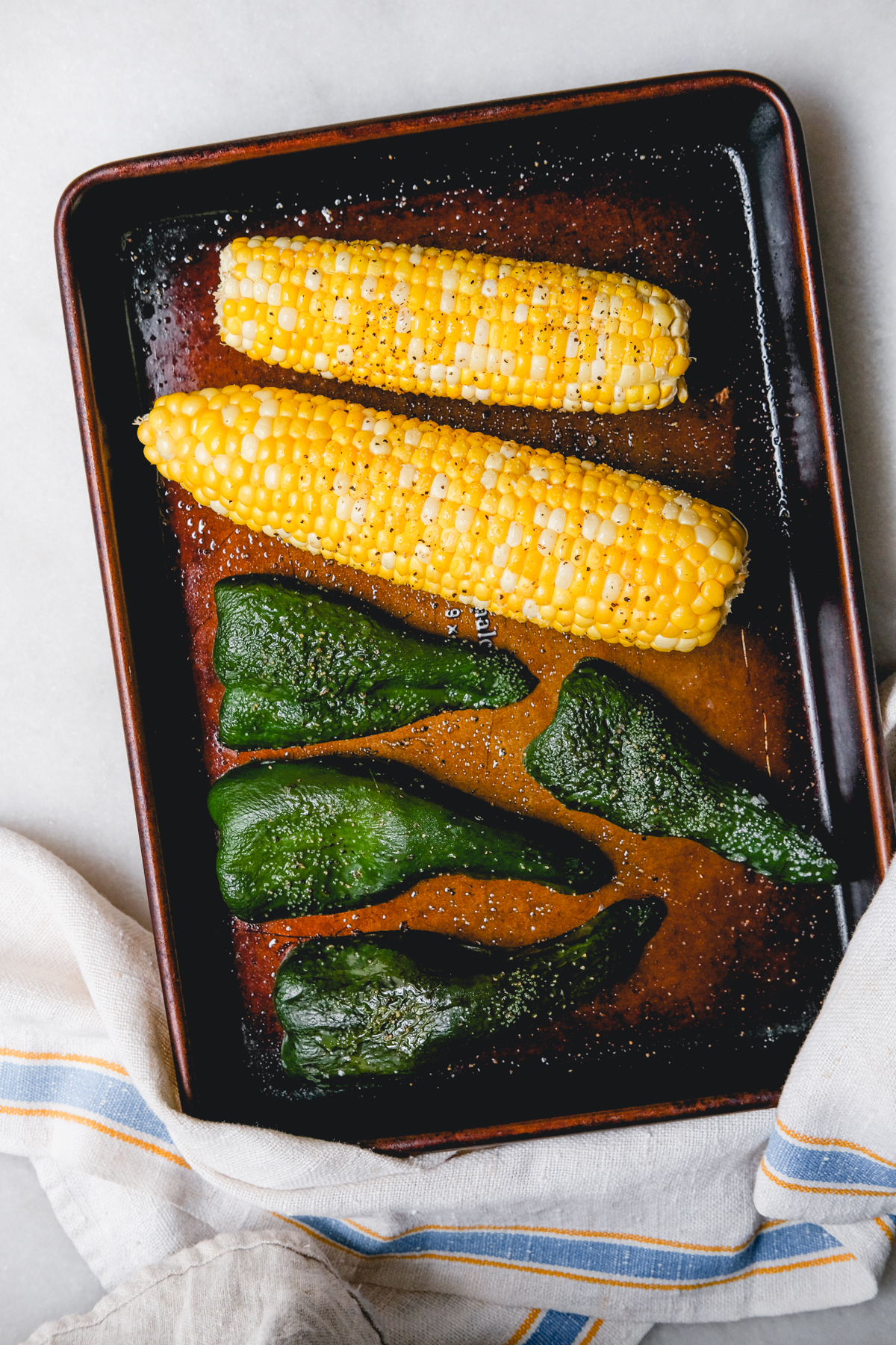 roasted poblano peppers and corn on a sheet pan